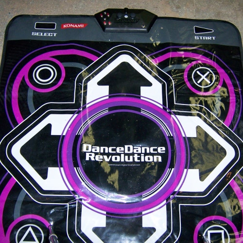 The completed PS3 controller within a USB dance pad